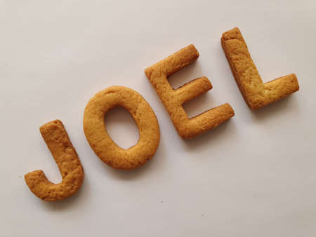 baked biscuits with shape of letters forming the name Joel