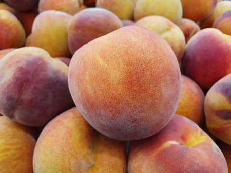 heap of peach fruit in a market, background and texture