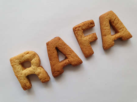 baked biscuits with shape of letters forming the name Rafa
