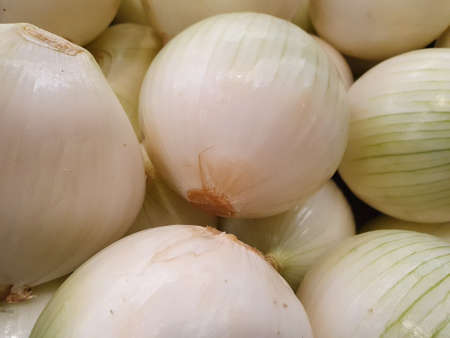 Heap of white onion in a market, background and texture Stockfoto