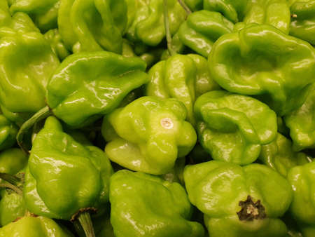 Heap of habanero peppers in a market, background and texture