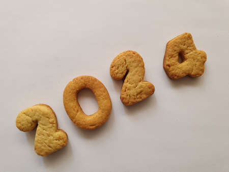 baked biscuit that form the number 2024, background for celebration and events