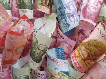 approach to costa rican banknotes and mexican money Stock Photo