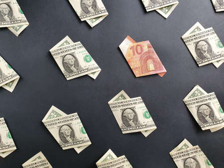 american one dollar bills and european banknote of ten euro on the black background Stock Photo