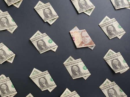 american one dollar bills and peruvian banknote of twenty soles on the black background Banco de Imagens