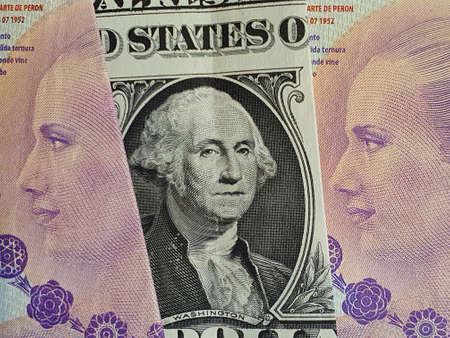 approach to american one dollar bill and argentine banknotes of 100 pesos Stock Photo