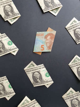 american one dollar bills and New Zealand banknote of five dollars on the black background Stock fotó
