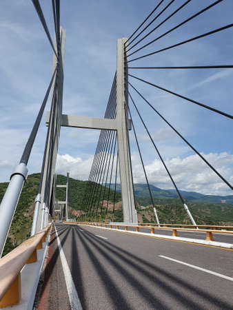 view of a bridge with a hydraulic cable structure on a highway
