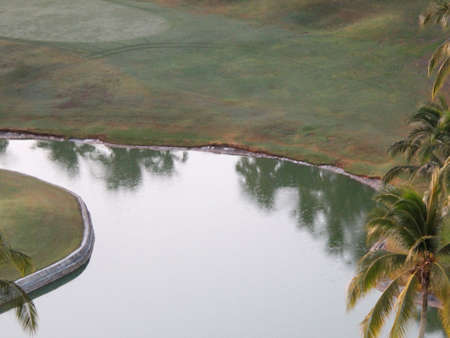 edge of a field pond to play golf with natural grass in a tropical climate zone