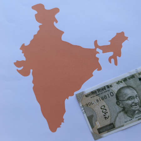 Indian banknote and background with India map silhouette
