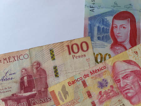 approach to mexican banknotes of 100 pesos and white background