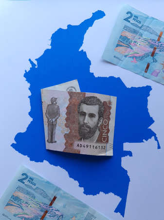 colombian banknotes and background with Colombia map silhouette