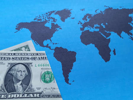 american one dollar bill and background with a world map in black and blue Foto de archivo