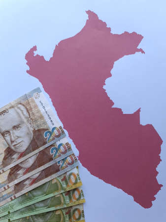 peruvian banknotes and background with Peru map silhouette