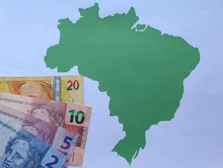 brazilian banknotes and background with Brazil map silhouette