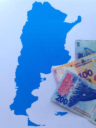 argentine banknotes and background with Argentina map silhouette