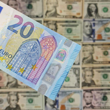 approach to european banknote of twenty euro and background with american dollar bills Foto de archivo