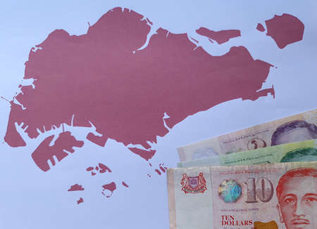 singaporean banknotes and background with Singapore map silhouette Foto de archivo