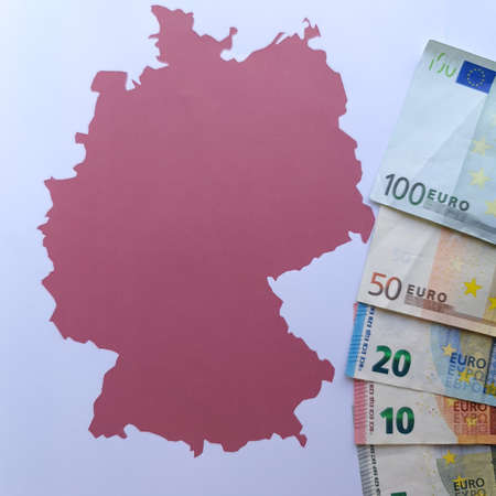 european banknotes and background with Germany map silhouette