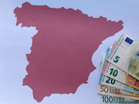European banknotes and background with Spain map silhouette Foto de archivo