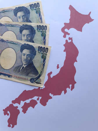 japanese banknotes and background with Japan map silhouette