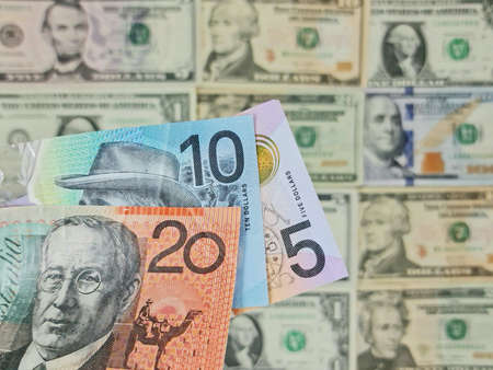 approach to australian banknotes and background with american dollar bills