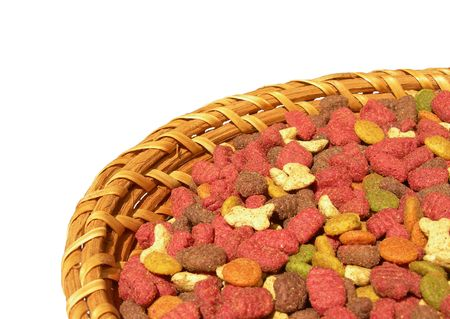 forage: Forage for cats in a wicker plate is shown in the picture.           Stock Photo