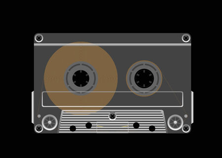 instrumentation: Compact cassette tape on a black background is shown in the picture