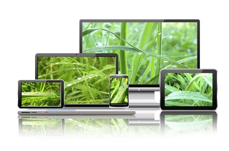 Laptop, tablet pc, mobile phone, TV and navigator with nature wallpaper are shown in the image  Stock Photo