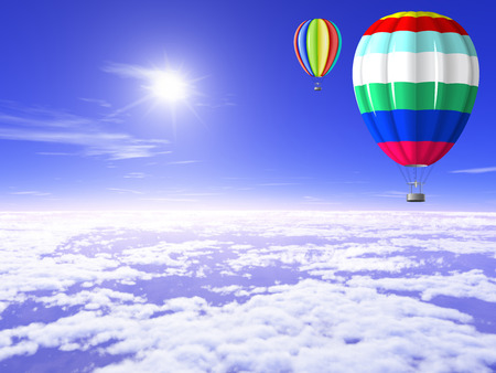 Beautiful, bright balloons floating in the sunny sky above the clouds. Stock Photo