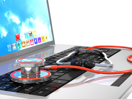 Stethoscope and laptop are on white background. Stock Photo