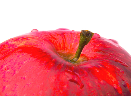 Red apple with dew drops on a white background close-up (HDR mode).