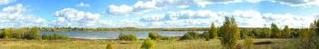 Lake, meadow, birch and cloudy sky in the autumn (panorama). Stock Photo