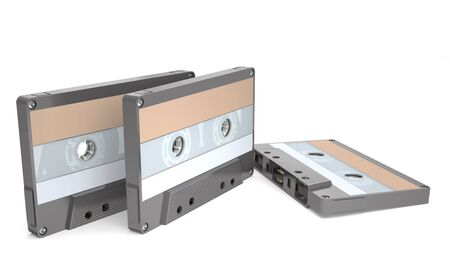 Outdated audio cassettes for an analog tape recorder on white background (3d illustration).