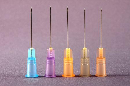hypodermic needles: hypodermic needles on grey background Stock Photo