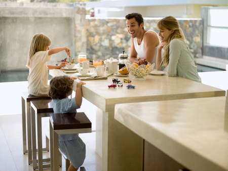 sitting at table: A family having breakfast LANG_EVOIMAGES