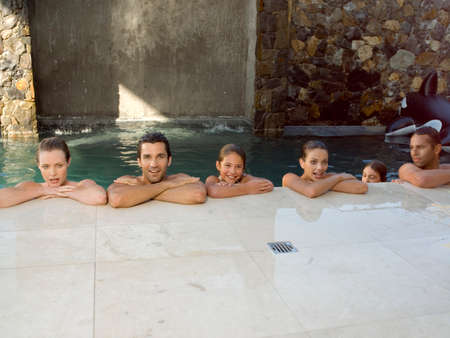 six persons: Parents and children in the swimming pool