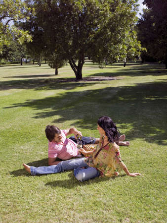 two persons only: Couple drinking wine in a park