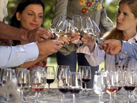 tasting wine: Wine tasters tasting wine