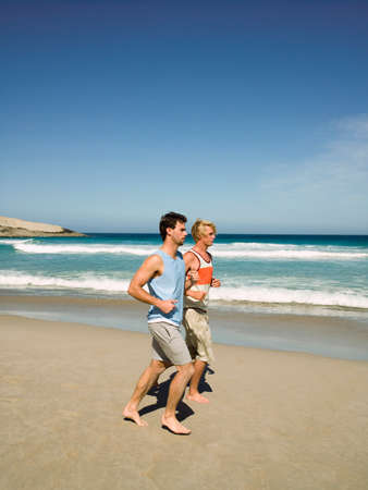 two persons only: Two men jogging on the beach