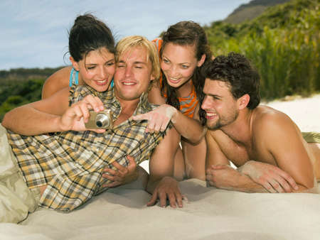 barechested: Friends looking at pictures LANG_EVOIMAGES