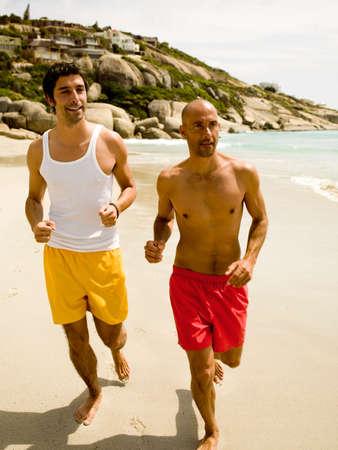 barechested: Men jogging on the beach
