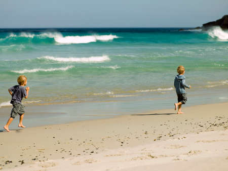 two persons only: Two young boys at the beach LANG_EVOIMAGES