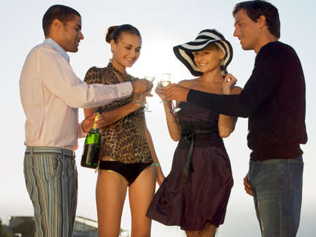 low blouse: Friends having champagne LANG_EVOIMAGES