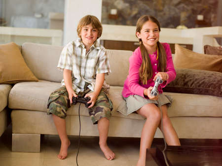 family: Children playing video game