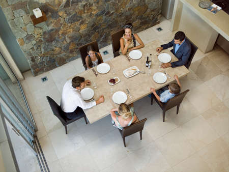 six persons: Family at the dining table