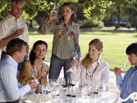 three persons only: Wine tasters tasting wine