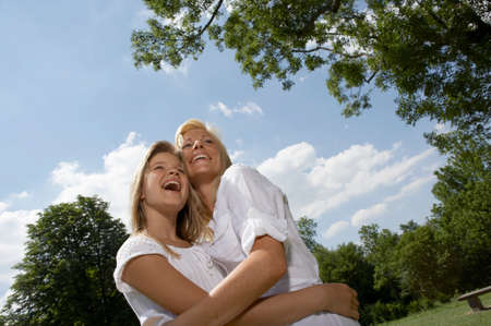 low blouse: Mother with daughter in a park