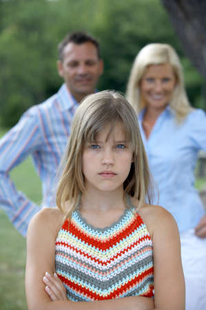 fringes: A girl looking upset from her parents