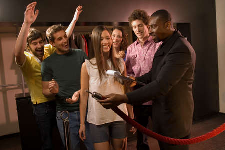 six persons: Friends entering a club